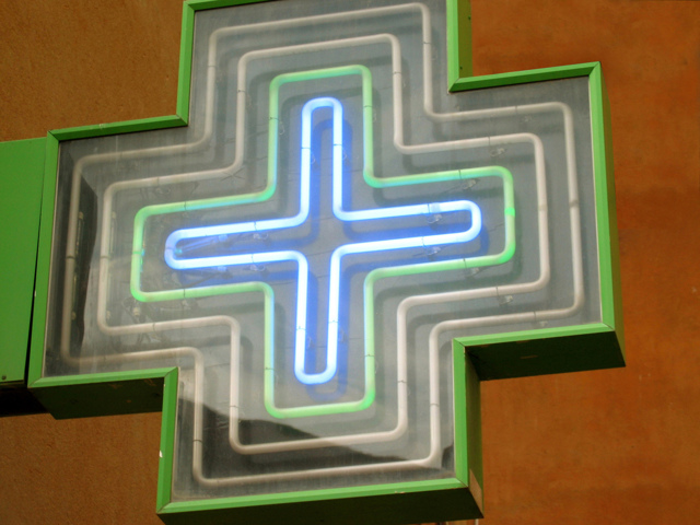 An image of a neon pharmacy cross