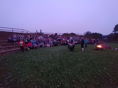 An image of a start of camp campfire
